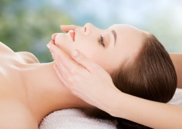 Woman receving face massage in spa.