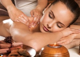 Closeup portrait of beautiful young woman with closed eyes relaxing in the spa salon. Beauty treatment concept.